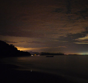 Caribbean beach at a peaceful summer night, captured by long exposure.